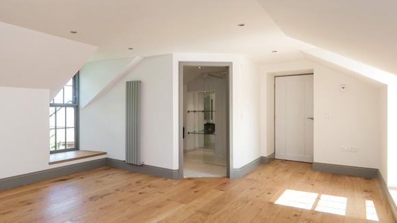 The master bedroom features underfloor heating and oak flooring.