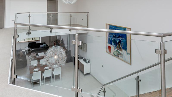 Each town house features an open-plan interior with a light-filled double height atrium.