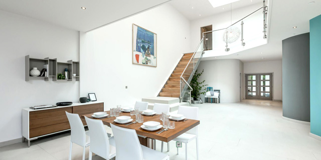 Flowing open-plan interiors offer a blend of cutting-edge design with warm, practical family living.