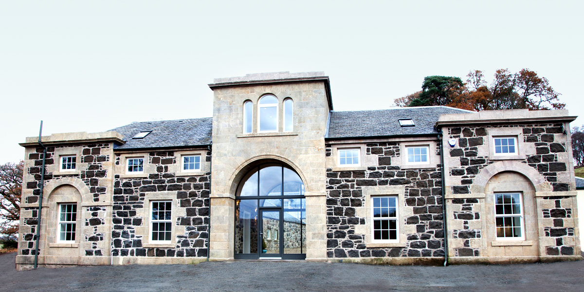 Gartur Stable - a Georgian Stable conversion featuring a glass arched entrance hallway.
