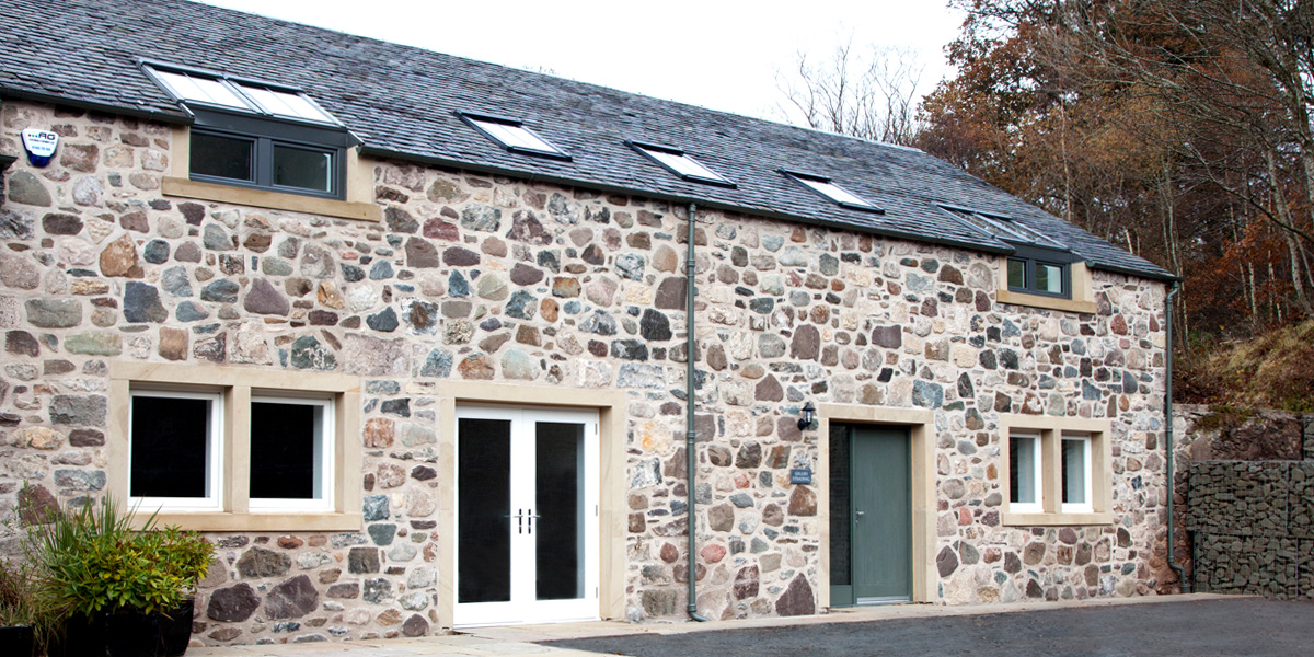 Newly built steading clad with original stone salvaged on site.